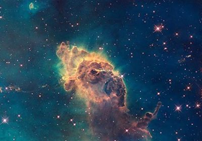 Jet in Carina Nebula. Composed of gas and dust. Scorching radiation and winds from nearby stars are sculpting the pillar and causing new stars. Elements of this image furnished by NASA.