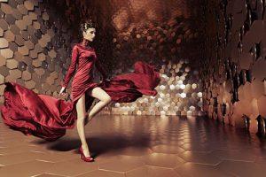 Glamorous woman with wavy evening dress